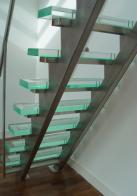 Three meters long, this is a bespoke stairs/ladder design with stainless steel stringers and acrylic treads with non slip surface strips. 2 handrails suitable for approaching a mezzanine or platform.