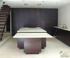 Bespoke Smokey Walnut Veneered Kitchen with Caesar Stone Worktops.