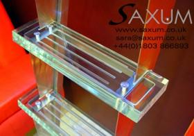An original concept for a stainless ladder with six laminated acrylic treads. Attached by integral hooks to a bespoke structural rail, the ladder can be moved horizontally in this plane
